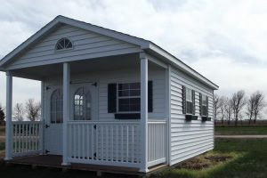 vinyl storage shed with porch