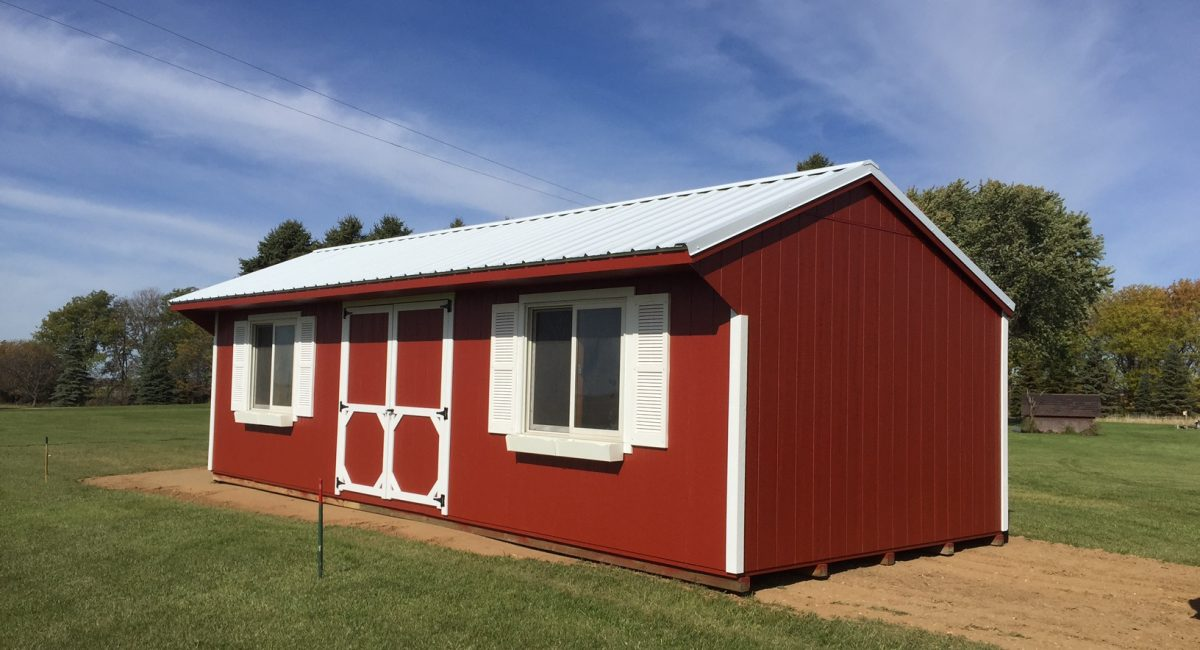 red wooden outdoor storage building for sale