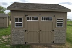 nice ranch style shed with stone and windows